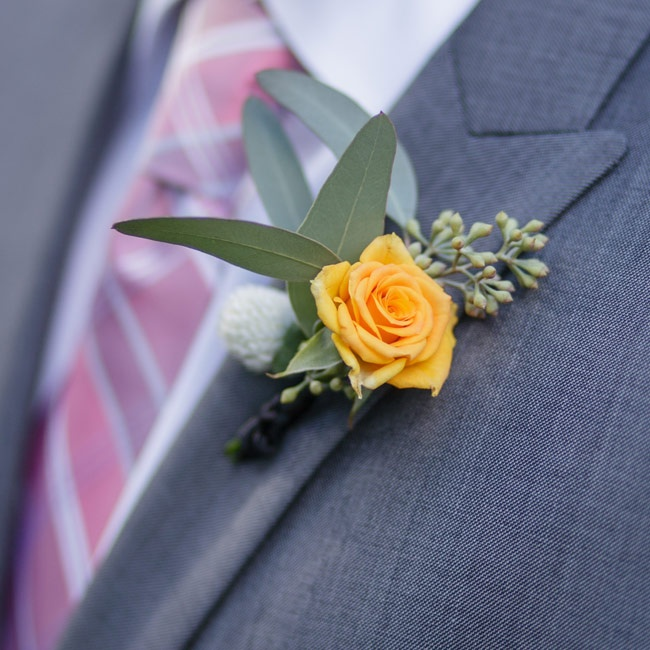 Groomsmen wore garden rose boutonnieres in marigold yellow and accented with bay leaves and seeded eucalyptus.