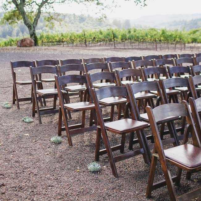 Dark wooden folding chairs were set up in traditional formation for the ceremony.