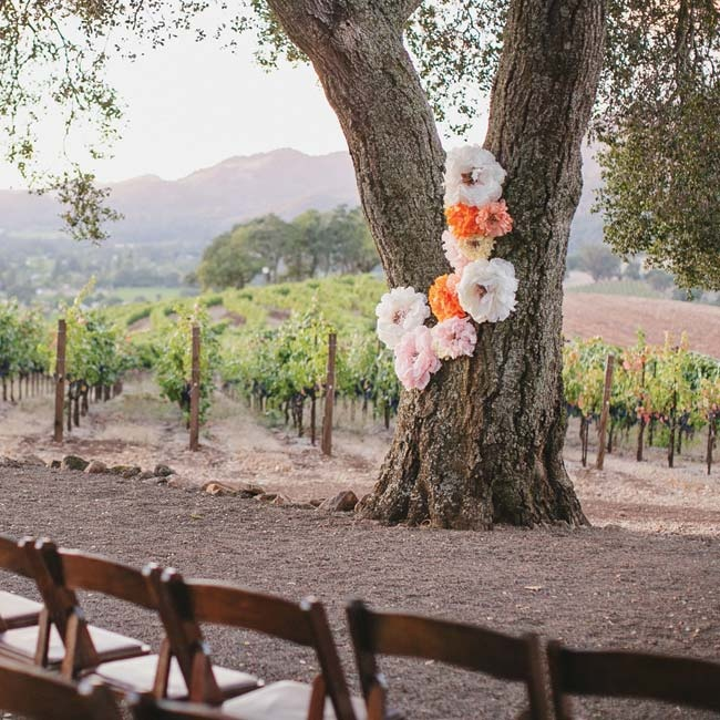 A whimsical arrangement of paper flowers in orange, blush and white gave the large tree an extra design element.