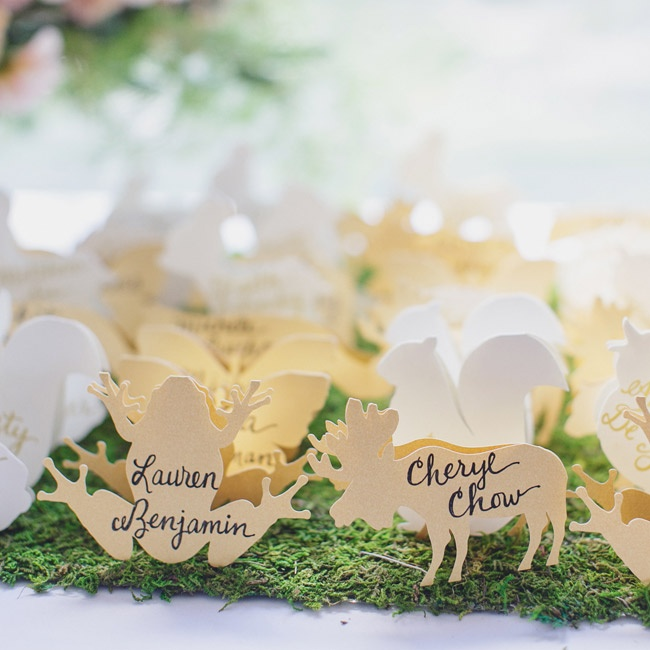 Carved wooden animals made for cute escort cards at the reception dinner.