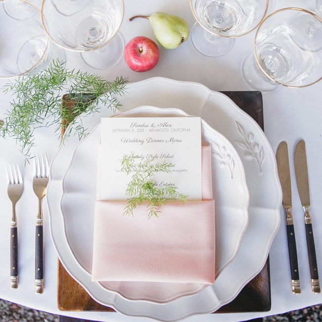 Simple white china with a leaf motif made a simple, but elegant place setting during dinner.
