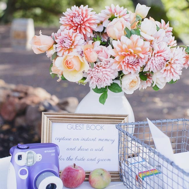 Guests snapped pictures with a Polaroid camera and wrote down a quick note for the bride and groom in the photo guest book.