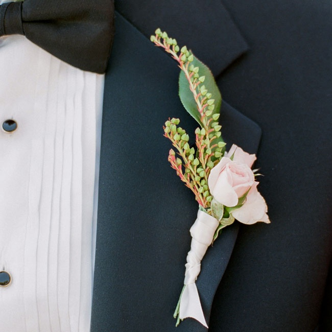 Greg wore a delicate pink rose boutonniere accented with lily of the valley.