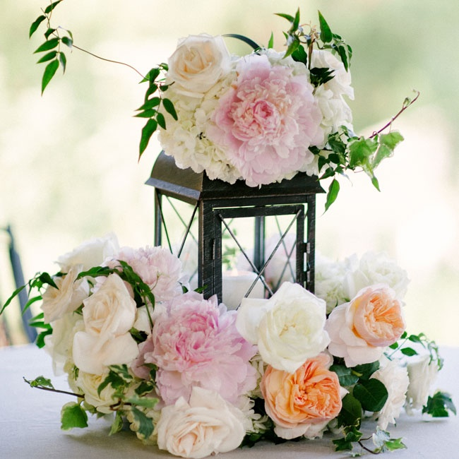 Vintage lanterns were decorated with lush wreaths of peonies and garden roses in shades of ivory, peach and pale pink.