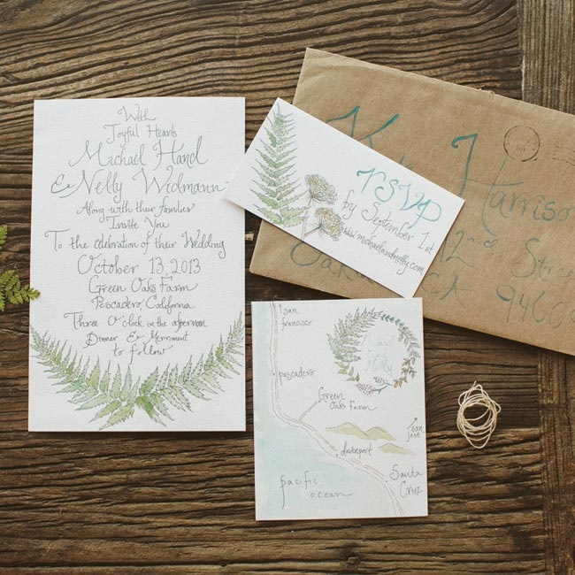 The couple's leaf motif was made by the bride and added a cohesive theme to their neutural invitation suite.