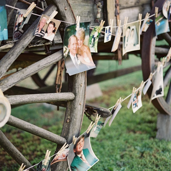 Kelly and Andrew strung photos of themselves and their family members along strings of twine set against a vintage chuck wagon backdrop.