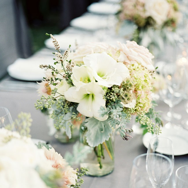 Small arrangements of white, pink and gray blooms like lilies, roses and lamb's ear were scattered along the reception tables.