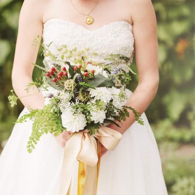 The bride's bouquet (from the local farmer's market) was full of white dahlias, ferns, scabiosa pods and hypernicum berries for added texture.