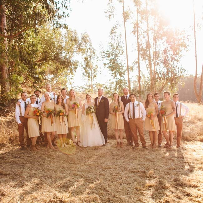 The wedding party stayed neutral and casual in tan colored bridesmaid dresses and suspenders for the groomsmen.