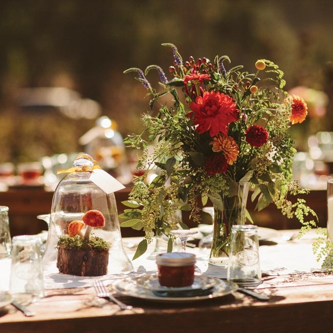 Warm autumn-themed dahlia centerpieces sat next to unique mushroom centerpieces covered in glass.