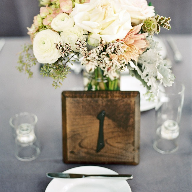 The table numbers were made from simple wooden blocks and cast iron numbers.