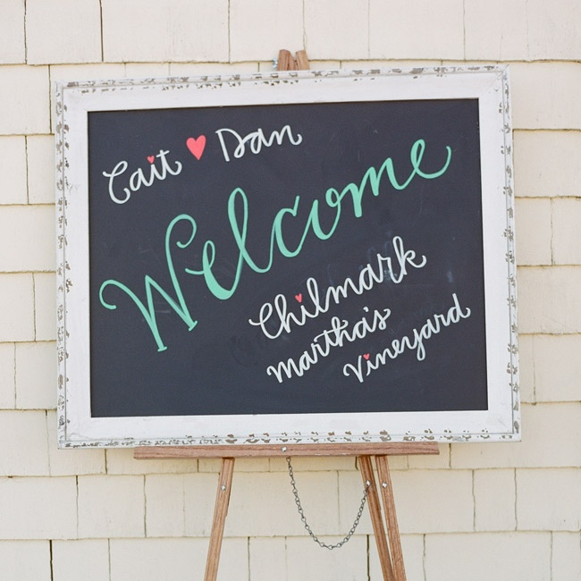Kate Yenrick, a close friend of Caitlin, designed the chalkboard welcome sign at the entrance to the tent.
