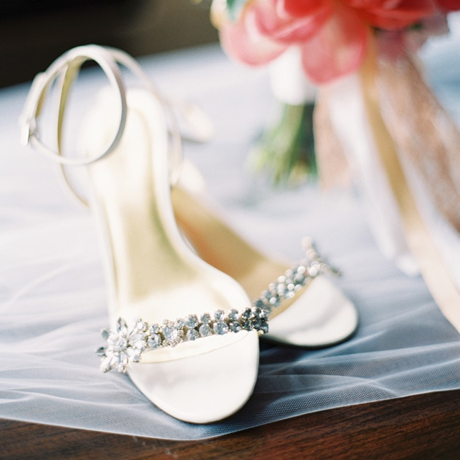 The bride wore kitten heels with an ankle strap and jeweled crystals along the toe.