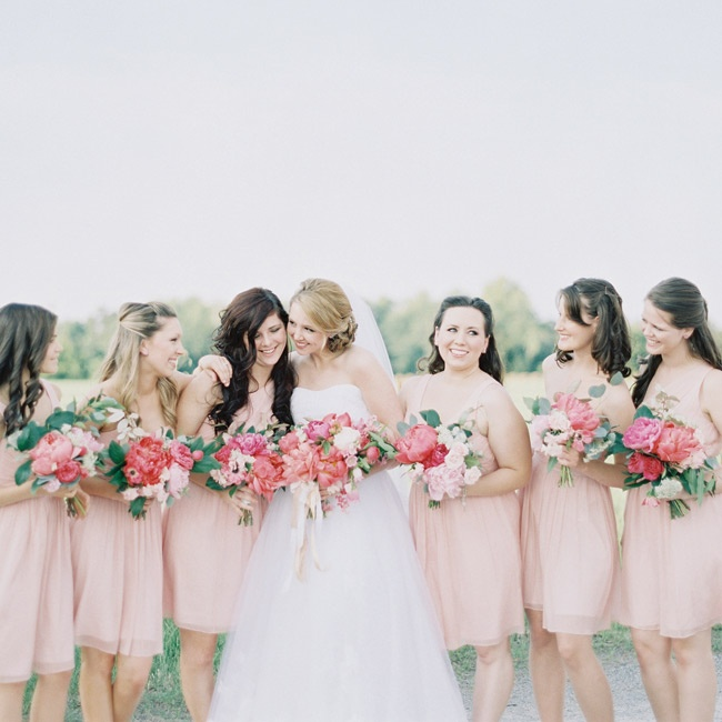 """Lauren chose blush chiffon dresses for her bridesmaids, but she let them pick the style. They settled on three options, with two girls wearing each style. """"It worked out beautifully!"""" Lauren says."""