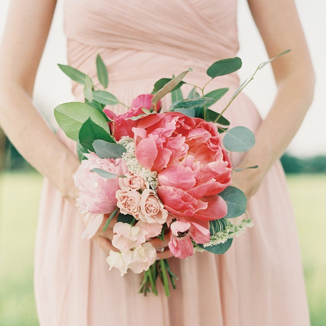 Lauren wanted her bridesmaids to wear light-colored dresses so that the vibrant flowers would really pop.