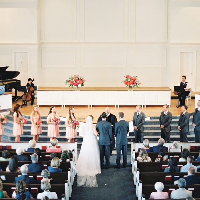 """Lauren's brother walked her down the aisle at their traditional church ceremony. The bride's father passed away from cancer, so they sang his favorite hymn, """"Amazing Grace,"""" during the ceremony as a tribute."""