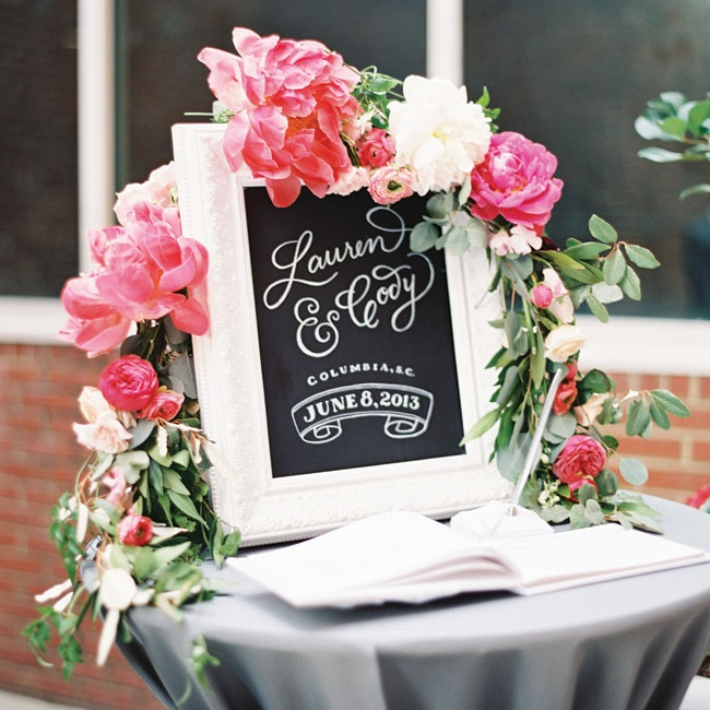 """Lauren illustrated this chalkboard sign that welcomed her guests to the reception. """"I wanted to put my own touch on as many elements of our wedding as I could,"""" Lauren says."""