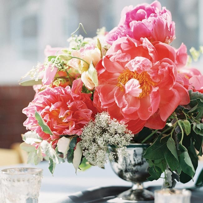 """""""I wasn't the kind of bride who wanted a spelled-out theme for her wedding, but I imagined it feeling like a charming, Southern garden party,"""" Lauren says. Large blooms in bright shades of pink helped achieve this atmosphere."""