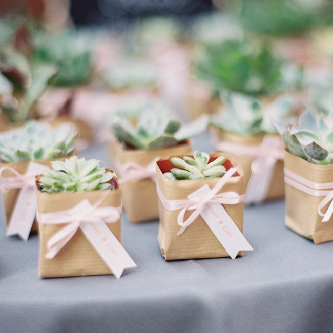 Guests took home potted succulents wrapped in craft paper, tied with a pink ribbon and adorned with a tag letterpressed by the bride.