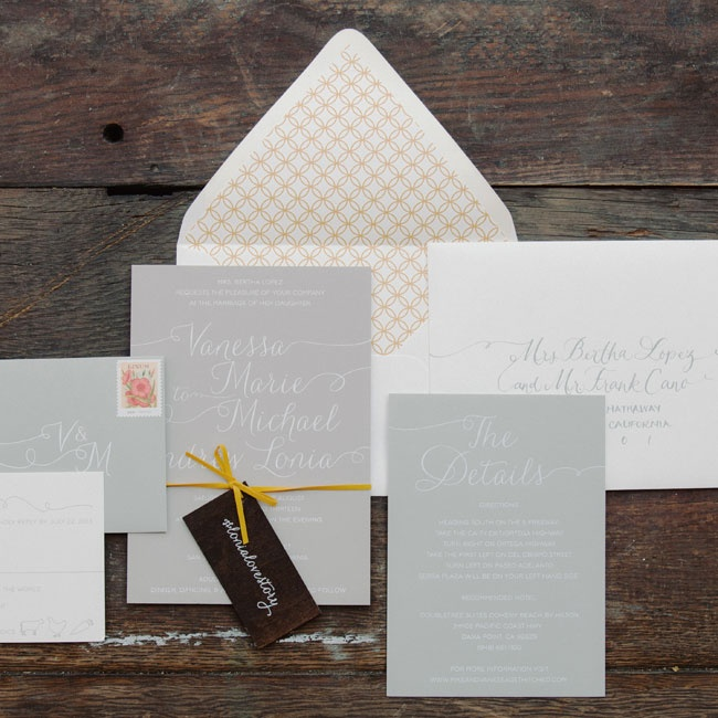 For their invitations, Vanessa and Mike went with a simple-yet-sophisticated white, gray and yellow color palette. The invitations were printed on thick museum board with white foil calligraphy style lettering. The enclosure cards were cream colored with gray script. All of the elements were bundled together with yellow suede rope.