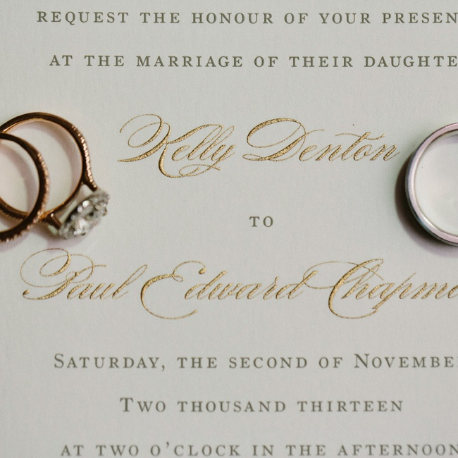 The couple chose classic, formal invitations with metallic accents. For rings, Kelly chose rose gold and Paul chose a simple white gold band.