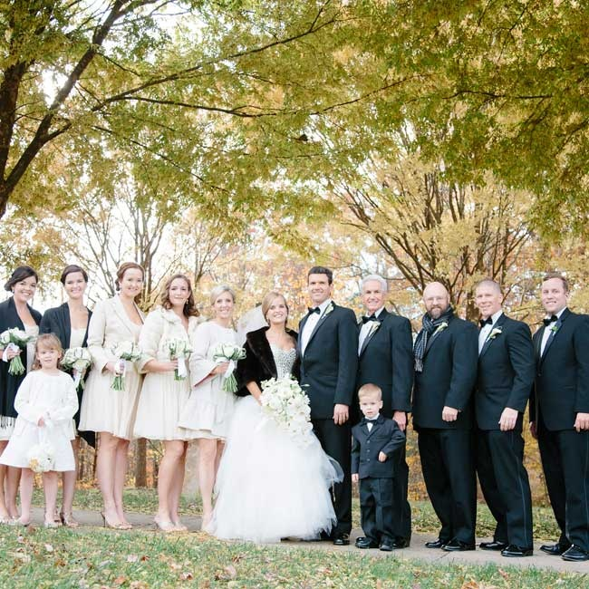 The bridesmaids wore short neutral dresses and the groomsmen wore classic black tuxedos.