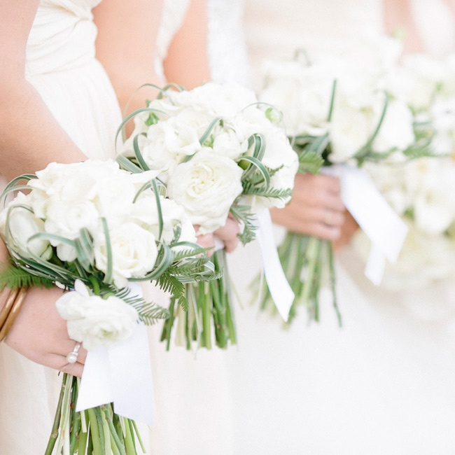 The bridesmaids' small bouquets were made up of white roses and ranunculuses.