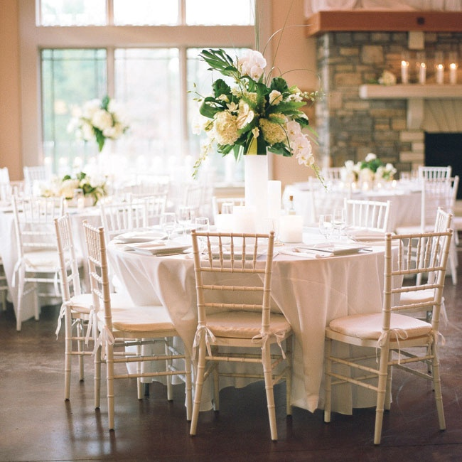 The reception tables had a mix of high and low centerpieces to add variety and depth to the room.