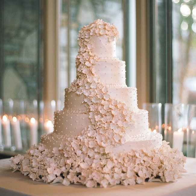 """The cake was the only thing I had ever dreamed about for my wedding day,"" Kelly says. ""The cake was so beautiful that we decided not to use a topper."""