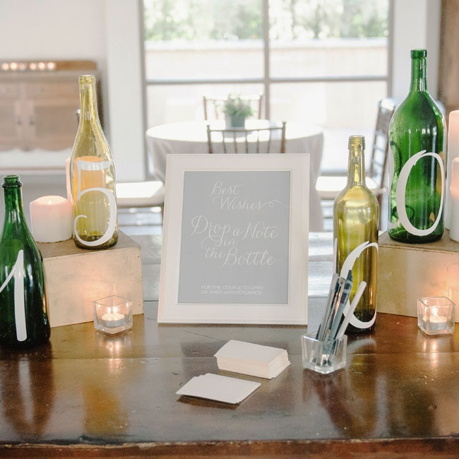 In lieu of a traditional guestbook, Vanessa and Mike had their guests write them notes on small pieces of paper and pop them into numbered glass bottles. The couple would then read the notes from each bottle on its corresponding anniversary.
