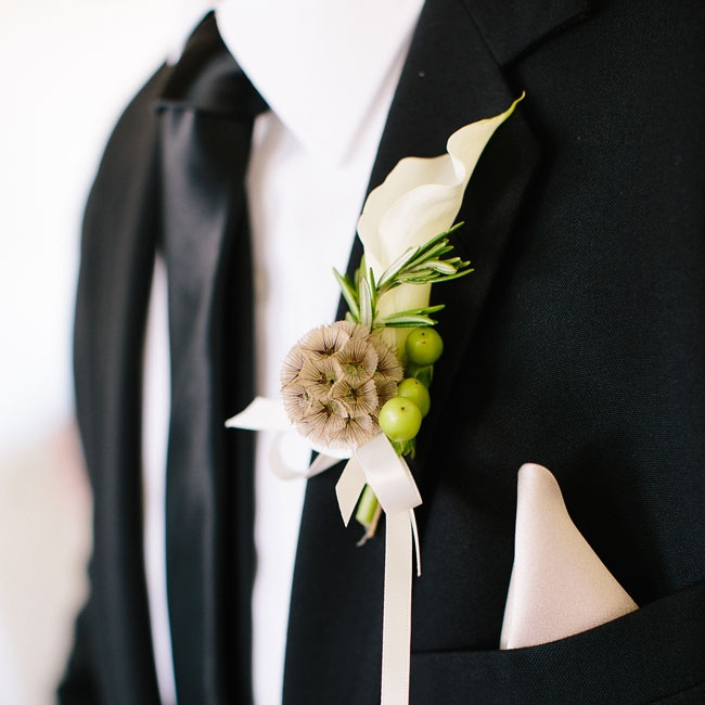 Scabiosa and a sprig of rosemary added an element of texture to Michael's white calla lily boutonniere.