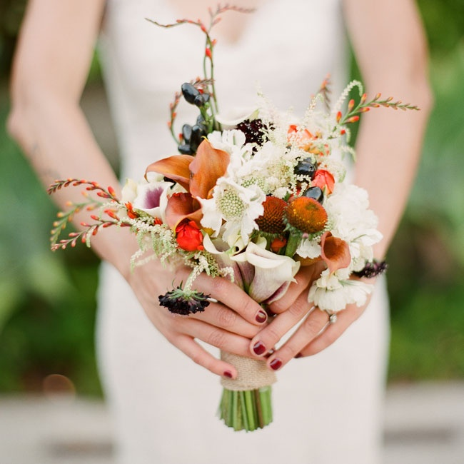 Jackie's unique bouquet was a mix of calla lilies, freesia, scabiosas and dahlias in shades of dark purple, orange, white and rust.