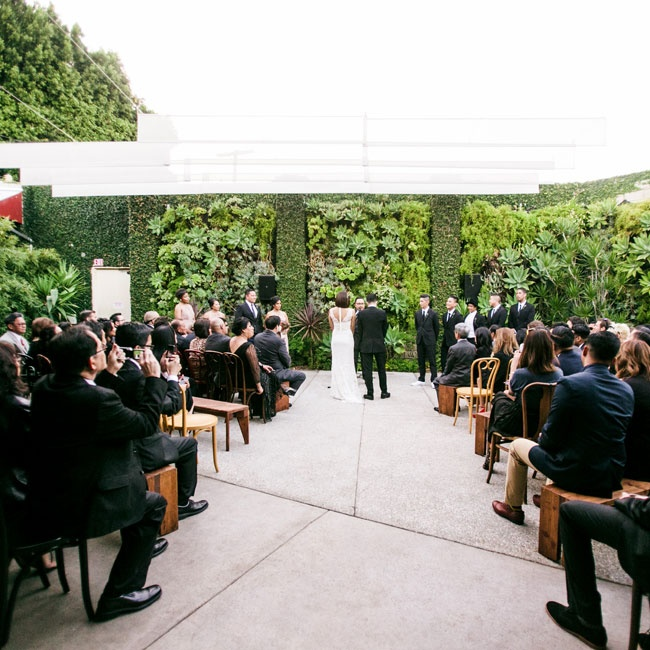 The ceremony took place outdoors in the garden courtyard at SmogShoppe. With it's lush living walls, the space needed little embellishment; the couple decided to let the beauty and uniqueness of the space take center stage.