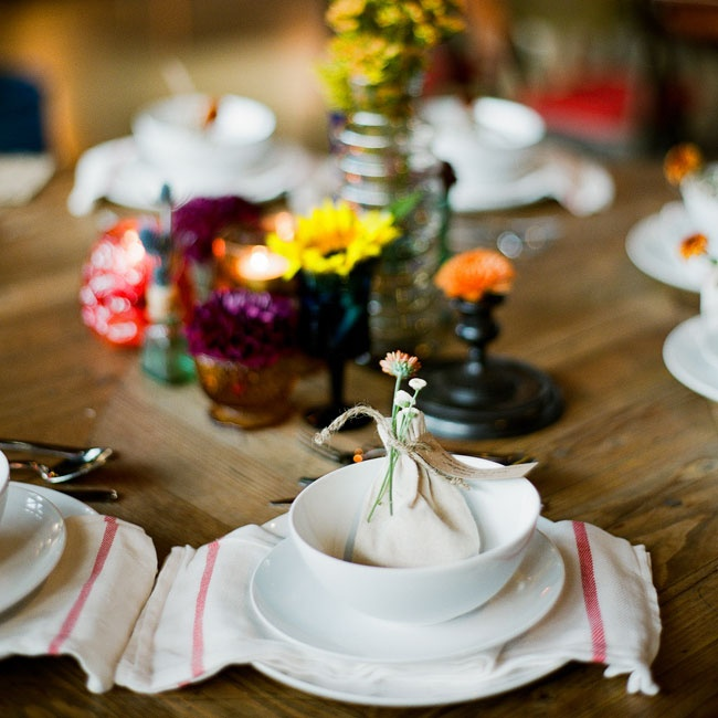The place settings had an understated country look with white china and striped cream and red napkins. Muslin favor bags filled with Mexican candies were placed at each setting.