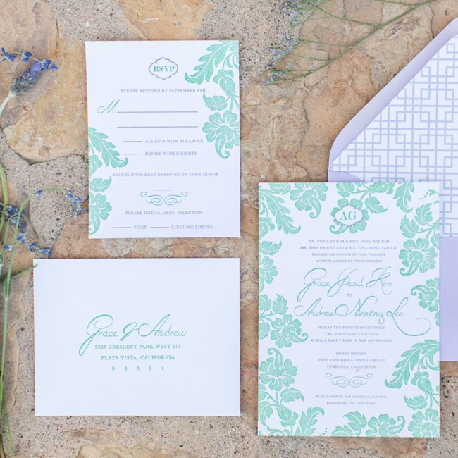 The invitation suite was decorated with a green floral letterpress design and purple and green letterpress typeface. The paper was tucked into purple envelopes lined with a purple and white pattern.