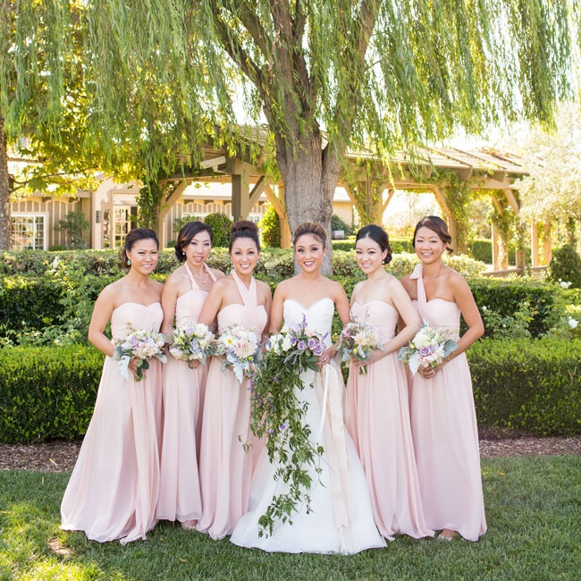 The bridesmaids wore blush floor-length gowns in strapless, halter and one-shoulder styles.