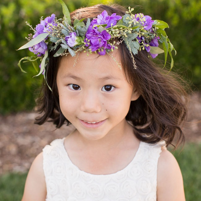 The flower girl wore a lush flower crown made from eucalyptus and bright purple flowers.