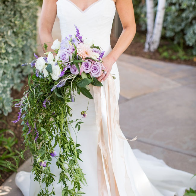 Grace's bouquet was filled with trailing jasmine vine, lavender, sage, garden roses, dahlias and lisianthus for a garden glam look.