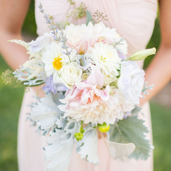 The bridesmaids textured bouquets were filled with dusty miller, berries, eucalyptus, lisianthus and lavender roses in soft pastel hues.