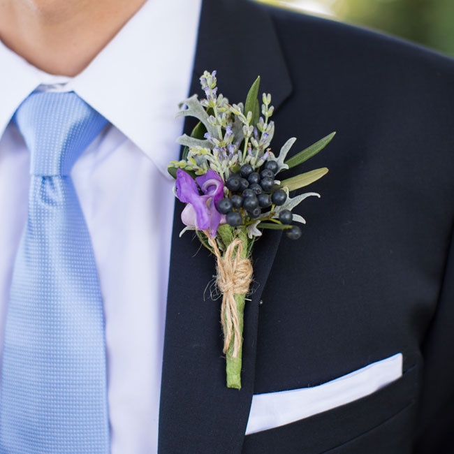 The groomsmen's boutonnieres were filled with unique elements like snail vine, acacia and black currents.