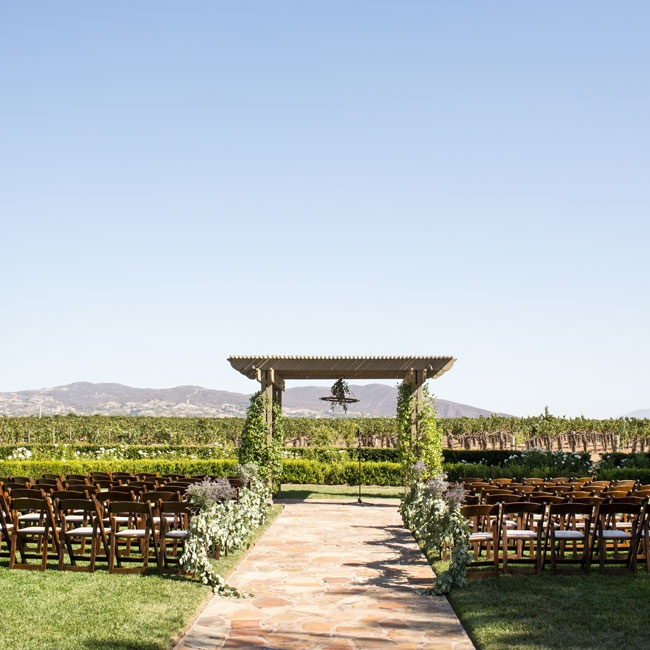 The ceremony took place in the Ponte Winery's Vineyard Garden under a large wooden pergola overlooking acres of vineyards.