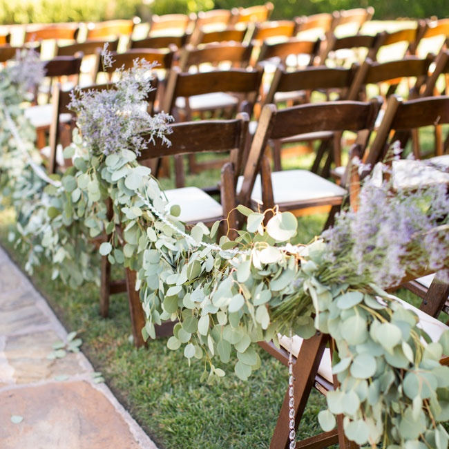To enhance the beauty of the vineyard setting, the couple decided to keep the ceremony decor simple. Lush garlands of silver dollar eucalyptus were draped along the aisles with fresh bunches of lavender placed at each chair.