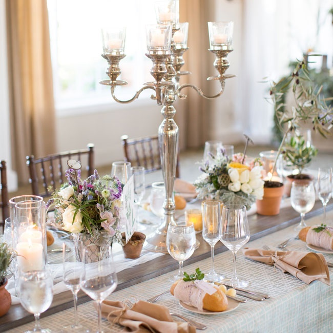 Silver candelabras were spread across each table, which cast a warm romantic glow over the tables as the evening went on.