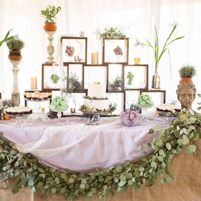 Potted plants, fresh herbs and a garland of eucalyptus gave the dessert table a whimsical, garden look.