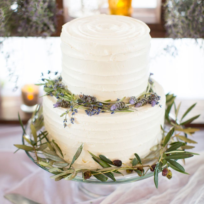 Sprigs of lavender and an olive leaf garland added a fresh, organic touch to the simple buttercream cake.