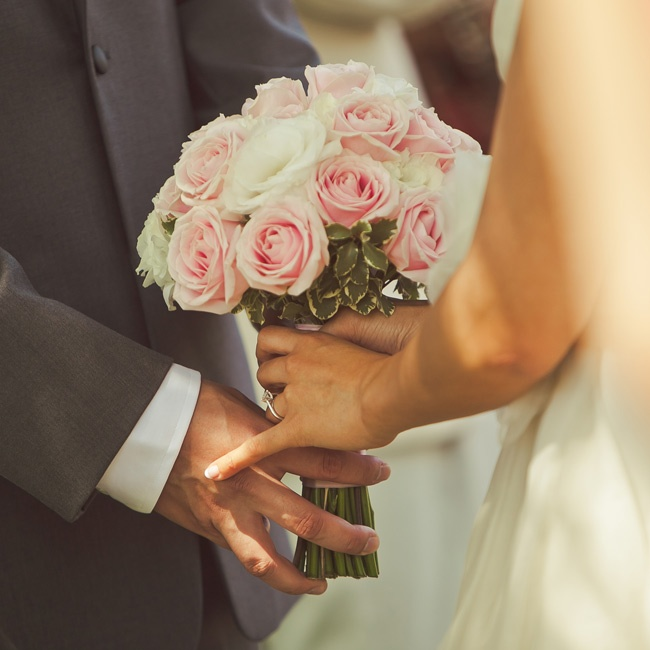 Joy opted for a traditional bouquet of roses in soft shades of ivory and pink.