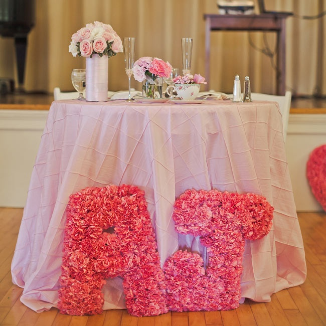 The couple's initials were made into pink carnation letters and placed in front of the sweetheart table at the reception.