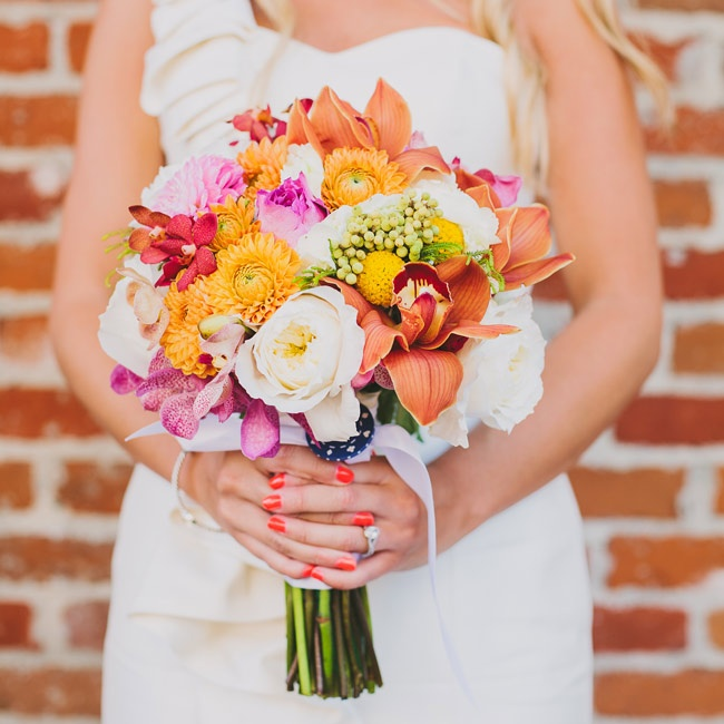 Christine's bouquet felt bright and cheerful with dahlias, garden roses, lilies, orchids and billy balls in vibrant shades of pink, orange and red.