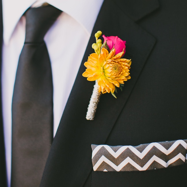 A bright orange dahlia and pink rose popped against Rich's black suit.