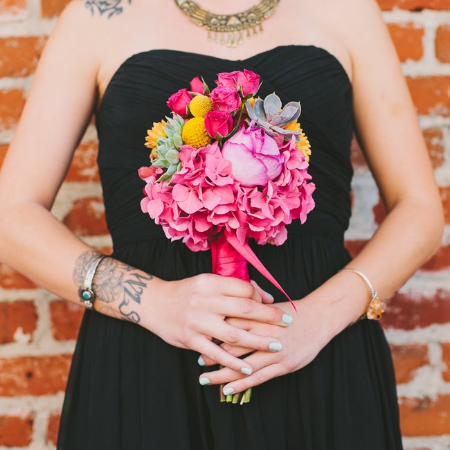 The bridesmaids carried vibrant bouquets of hydrangeas, roses, billy balls and succulents that popped against their black dresses.